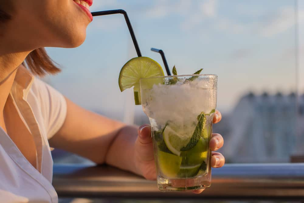 A woman drinking a cocktail