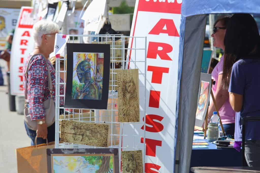 Artists sell wares at a festival in the Eau Gallie Arts District, one of the best things to do in Melbourne, Florida.