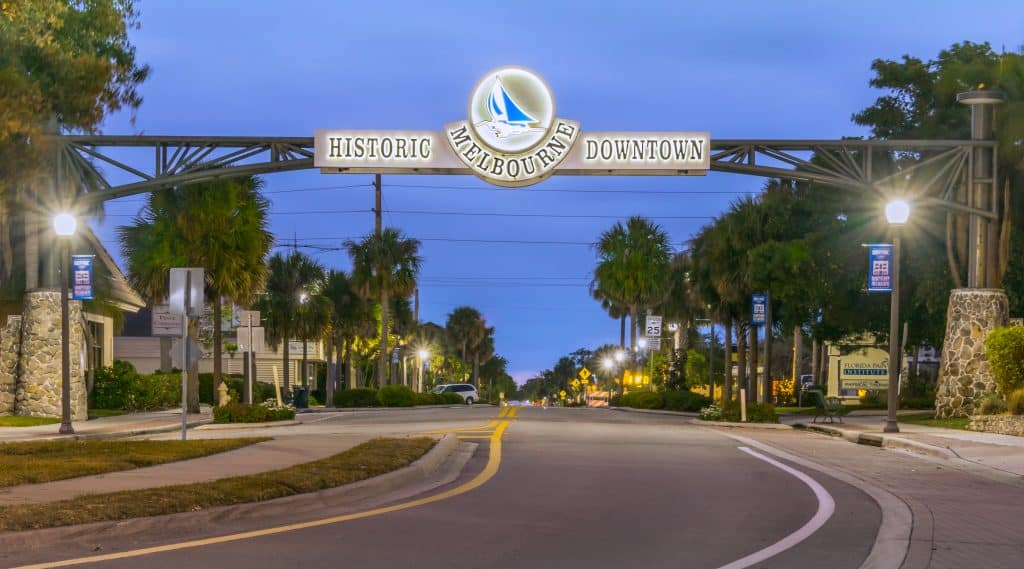A quaint and jaunty sign covers the entrance to Historic Downtown, one of the best places to go in Melbourne, Florida.