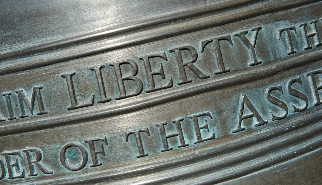 A close-up of the inscription of the Liberty Bell replica at the Liberty Bell Memorial Museum.