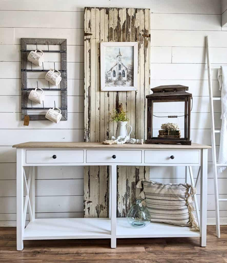 A white console and a pair of salvaged cabinet doors on display at the Rehab Vintage Market.