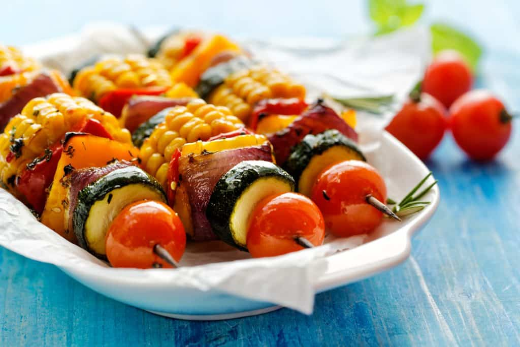 A set of kebabs filled with vegetables, grilled to perfection.