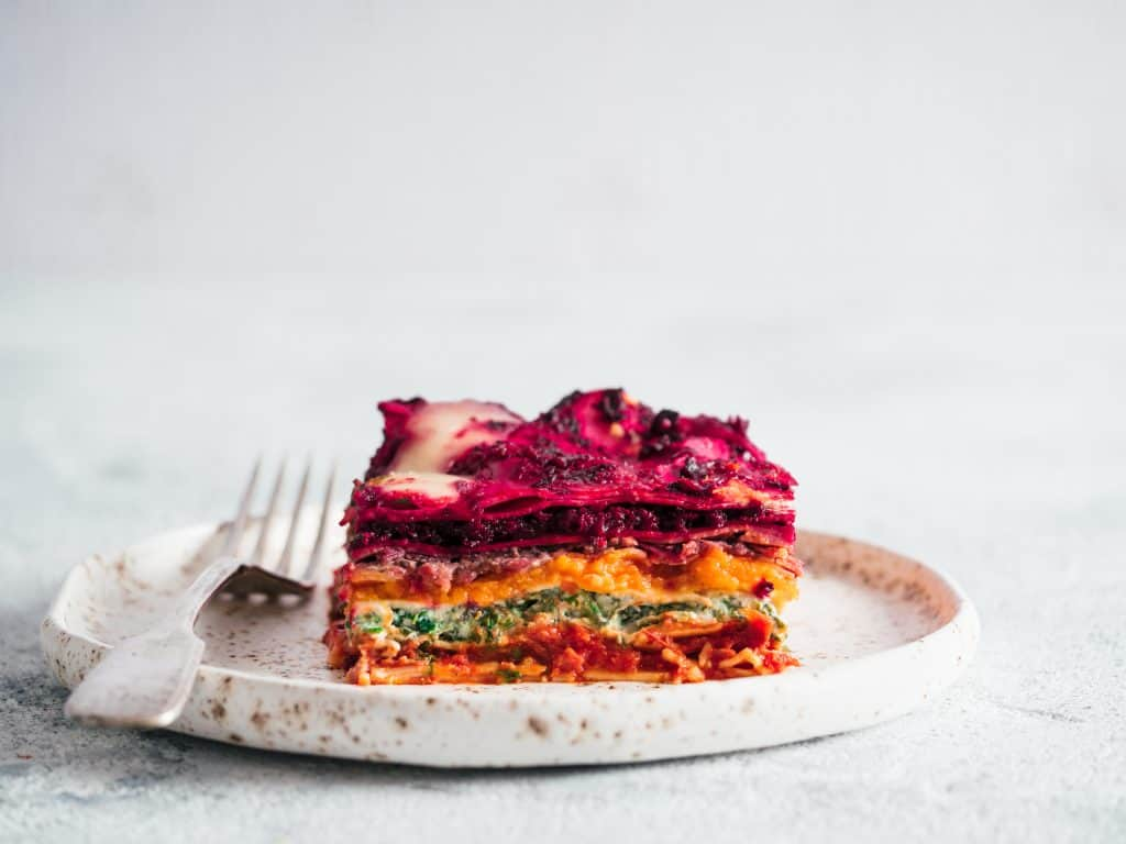 A slice of a delicious vegetable pie, perfect for eating vegan in Tampa.
