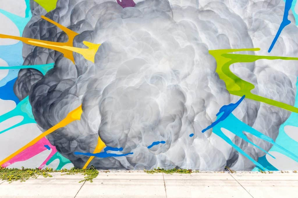 A mural at the Wynwood Walls depicts an explosion with bright neon colors.