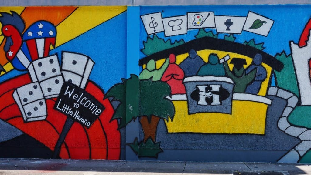 A bright, colorful mural indicates the entrance to Little Havana from the Wynwood Walls.