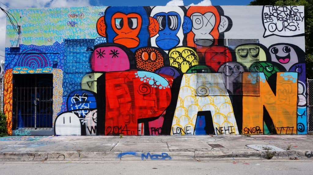 A mural features chunky lettering and crudely drawn monkeys in bright colors.