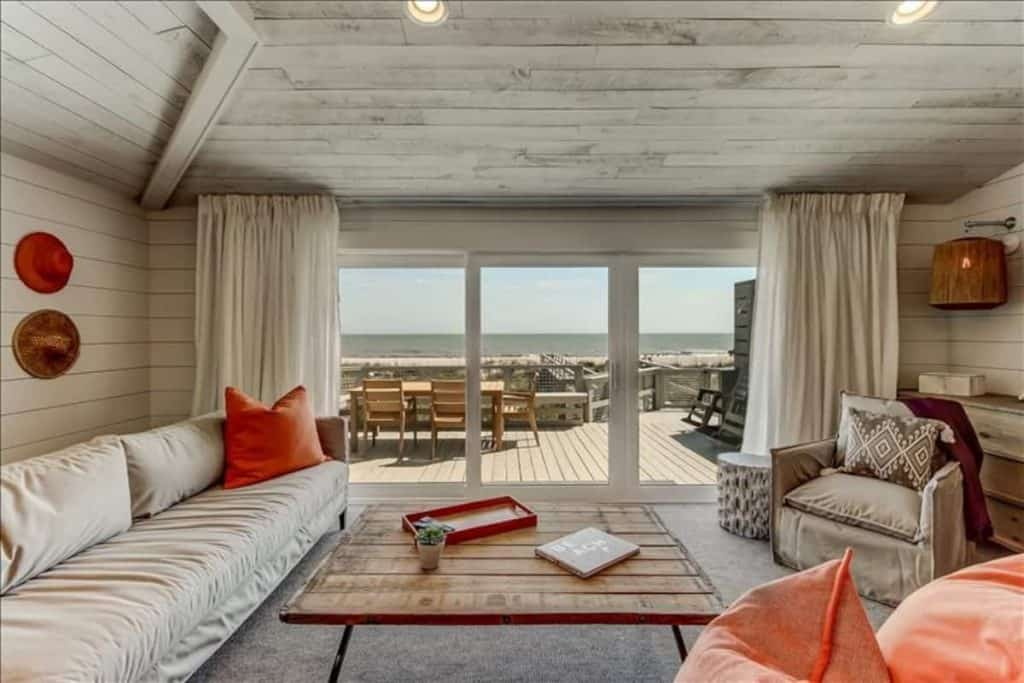 Photo of the living room with oceanfront view inside an Airbnb in Florida.