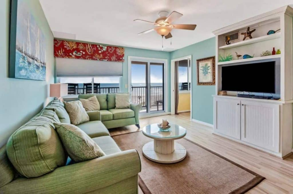 Photo of the living room and beach view inside an Airbnb in Florida.