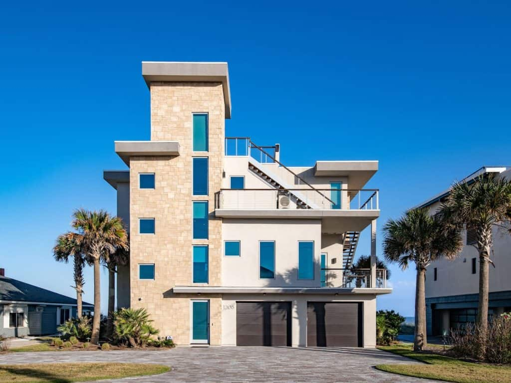 Photo of the exterior of an oceanfront designer masterpiece which is one of the luxurious Amelia Island Airbnbs.