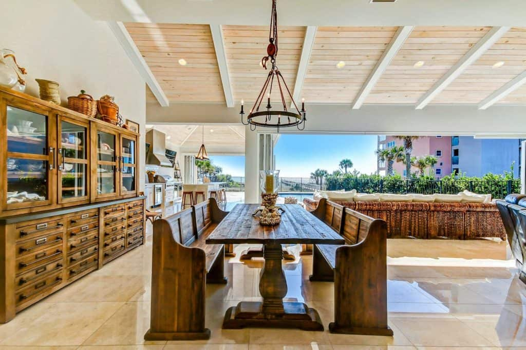 Photo of the dining table, cabana, and outdoor dining inside a resort-style luxury home Airbnb.