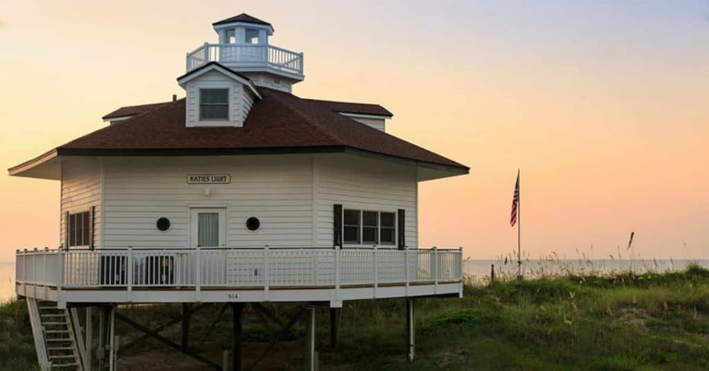Photo of the exterior of an Airbnb property that is a lighthouse replica.