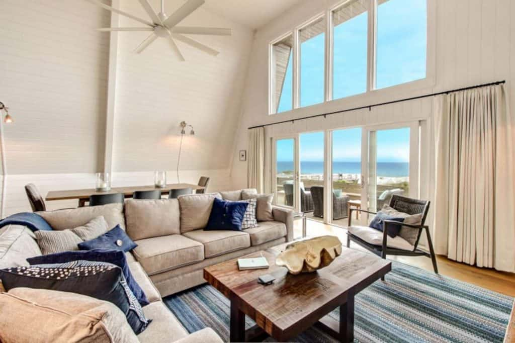 Photo of the living room and oceanfront view inside an Airbnb on Amelia Island.