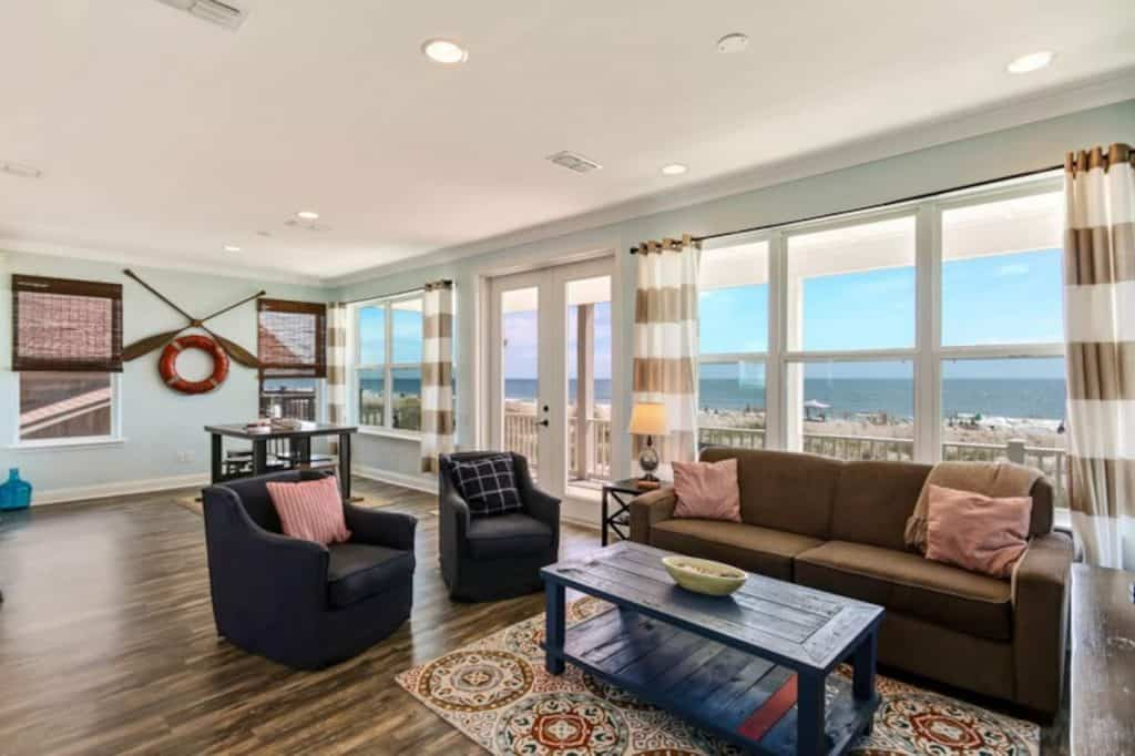 Photo of the living room inside a modern and spacious beach house Airbnb.