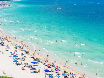 Head to one of the beaches in Miami
