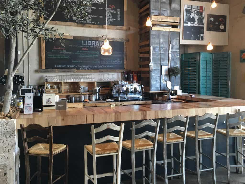 The bar area of a quaint coffee shop in Miami.