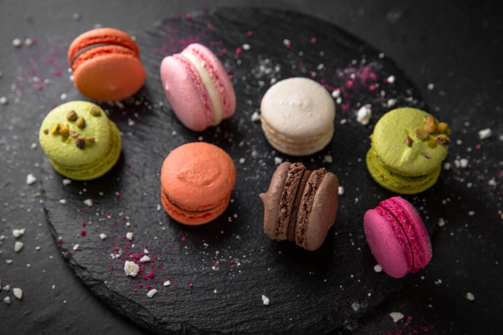 A series of macrons, served alongside the best coffee in Miami.