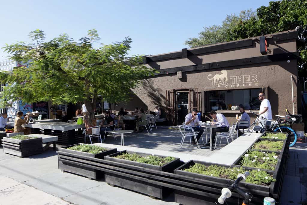 The exterior seating area of Panther Coffee in Miami.