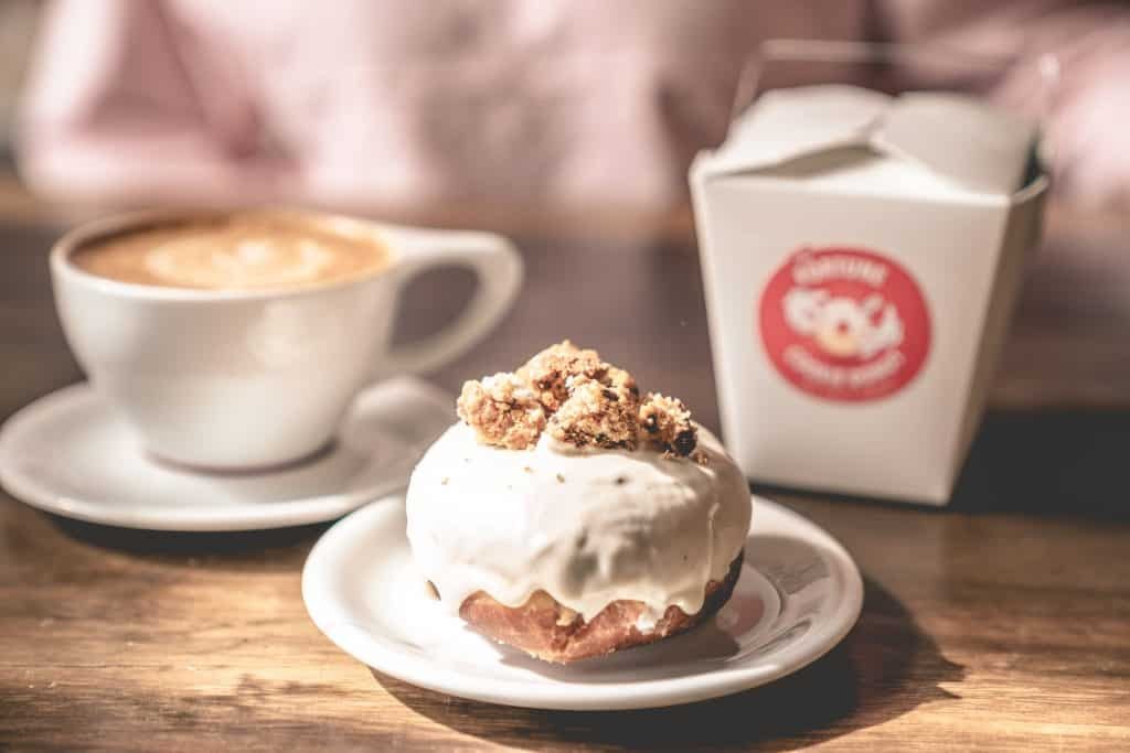 A cronut and a latte as served at the Salty Donut, one of the best coffee shops in Miami.