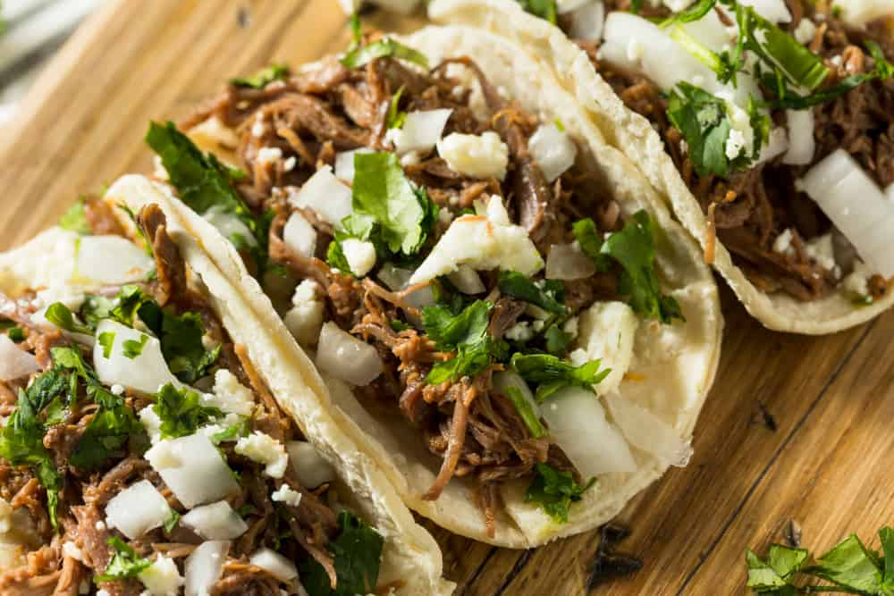 Grab a delicious taco at Tin and Taco a craft experience paired with craft beer near the stadium