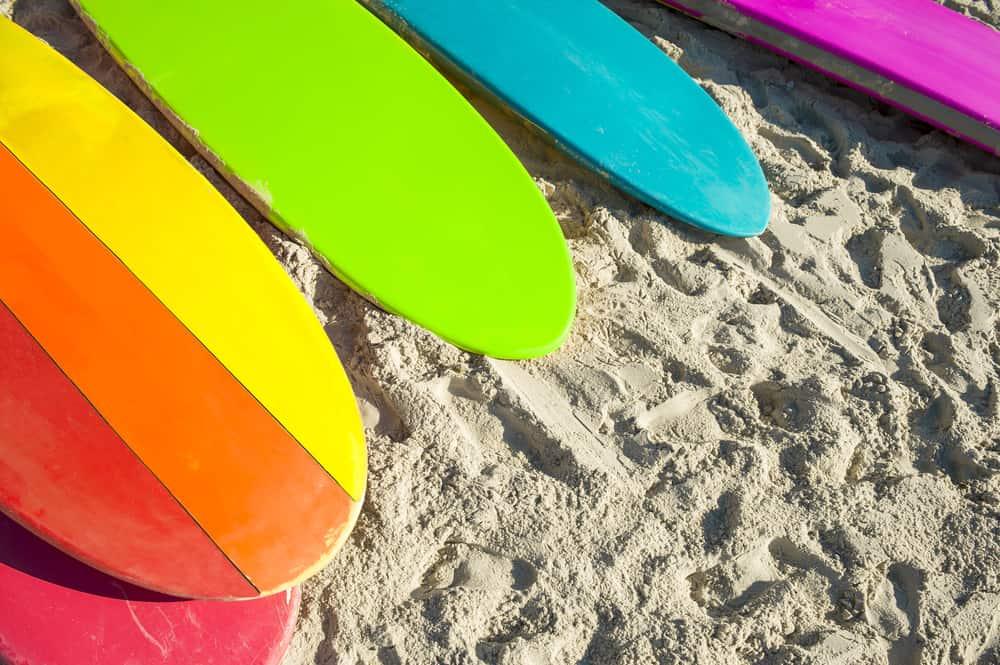 Rainbow surfboards on a beach