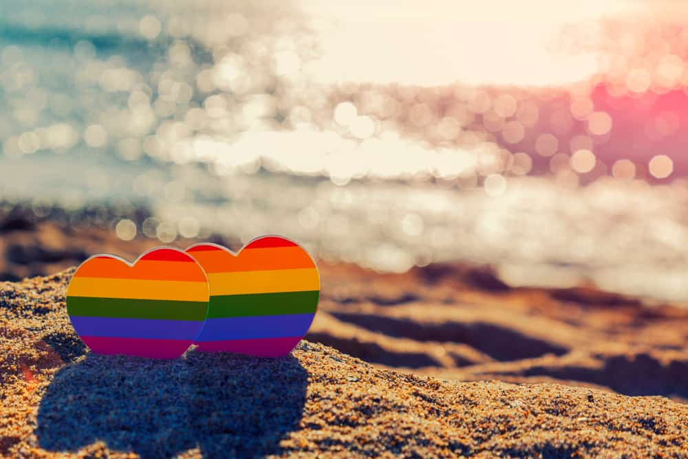 Two love hearts on a beach in an article about gay beaches in Florida