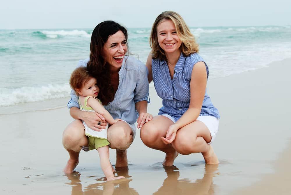 A modern family on the beach