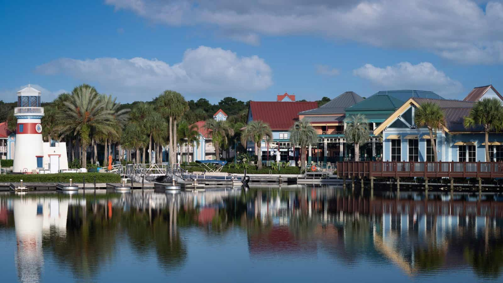 The quaint skyline of a small town in Florida is reflected in the water.