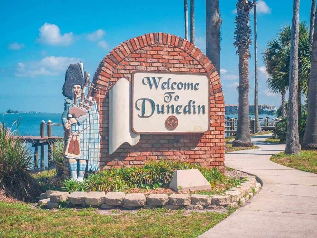 A Scotsman statue playing the bagpipes welcomes guests into the city of Dunedin, one of the cutest small towns in Florida.