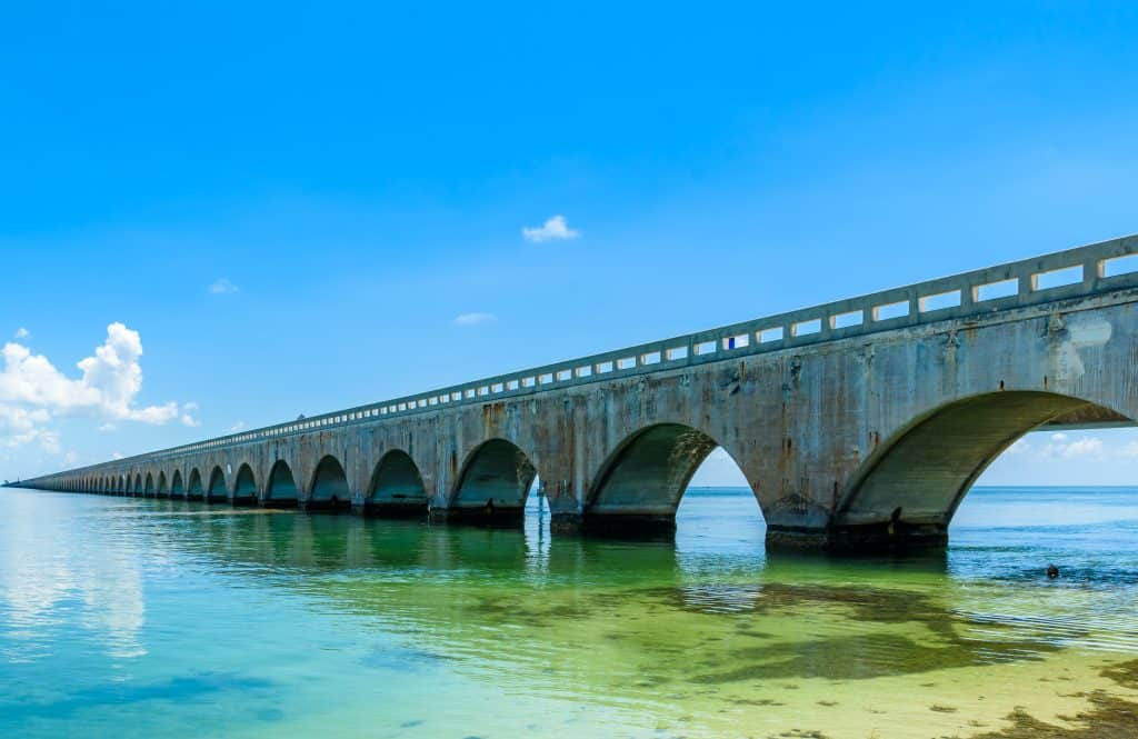 The Florida Keys Overseas Heritage Trail hovers over crystal clear waters.