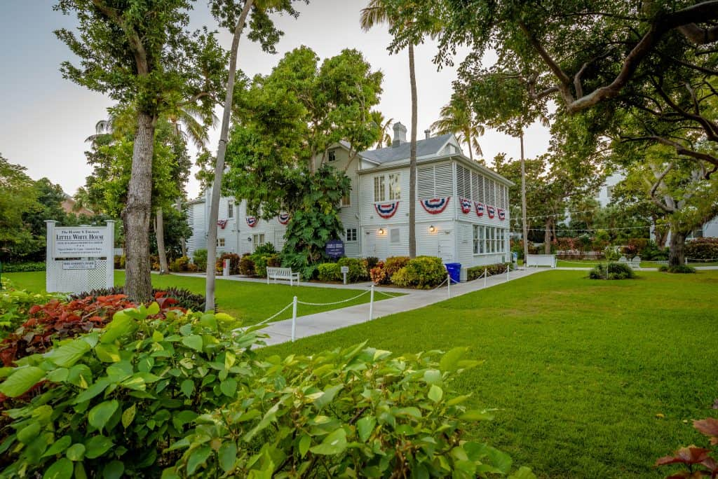 The Harry S. Truman Little White House sits surrounded by lush foliage, one of the best things to do in the Keys.