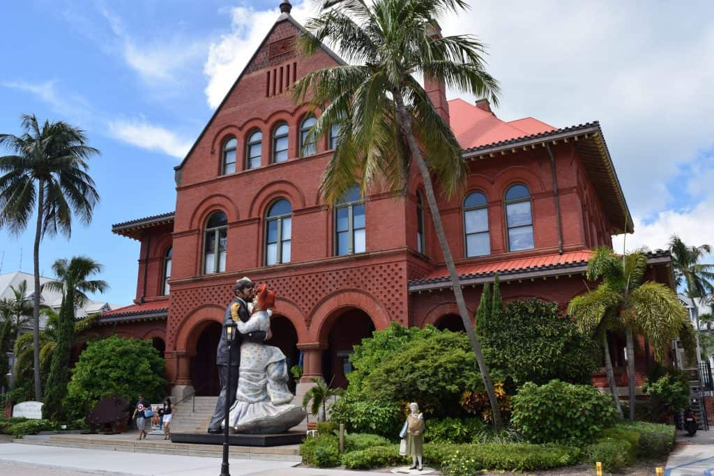 A statue of a couple dancing marks the entrance to the Key West Art & Historical Society.