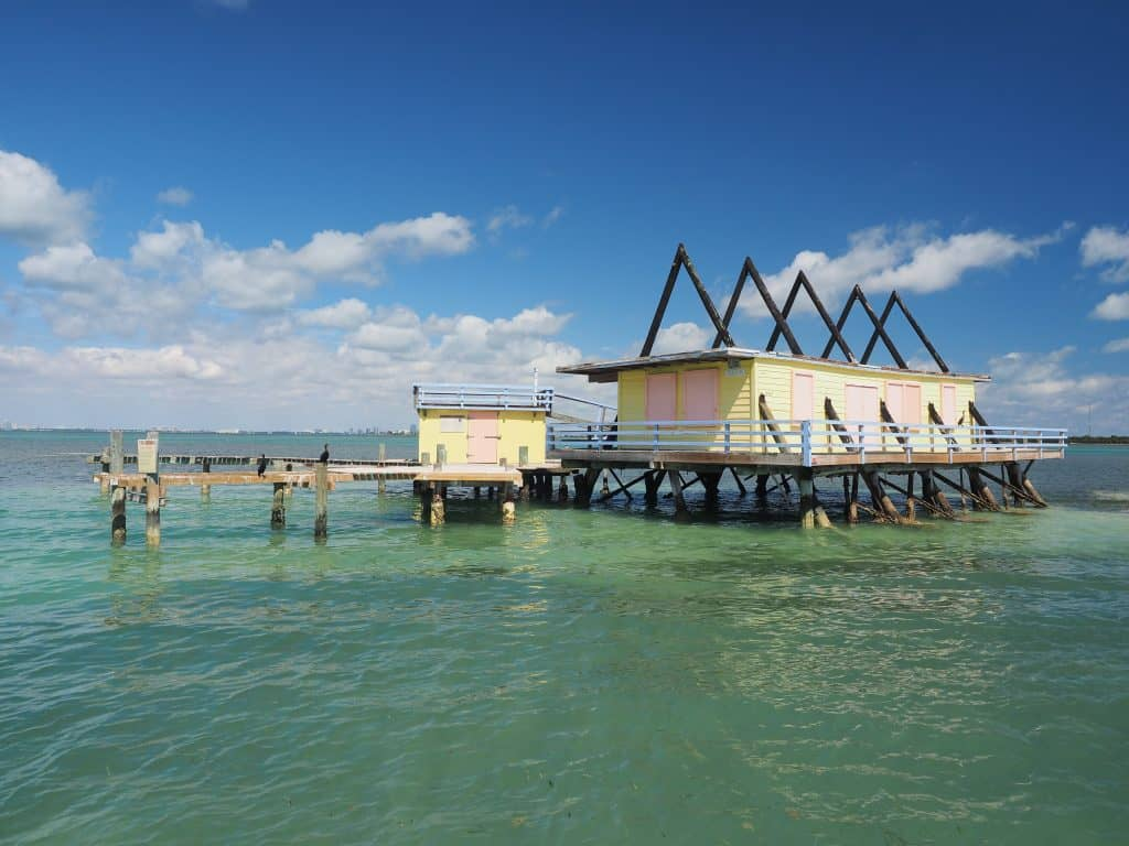 A colorful abandoned home in the water town of Stiltsville, one of the best things to do in the Keys.