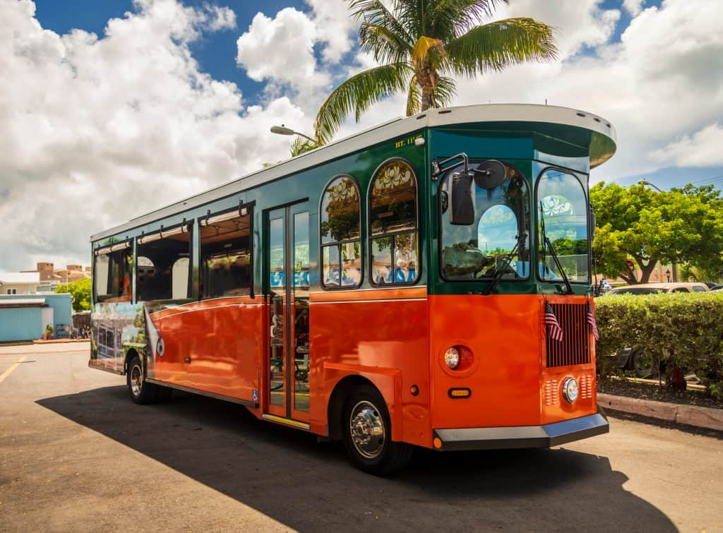 Photo of a bright red-orange Old Town trolley, which is part of one of the best Key West Tours.