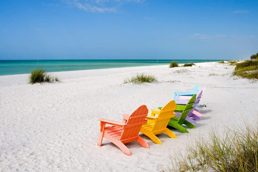 Beach chairs are lined up on the beaches of Captiva Island, one of the best day trips from Naples.