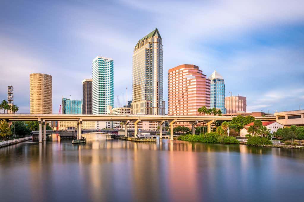 The Tampa Bay skyline shimmers in its reflection in the Hillsborough River, one of the best day trips from Naples.
