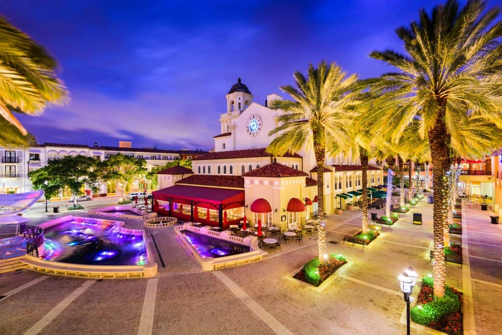 Rosemary Square is lit at dusk in West Palm Beach.