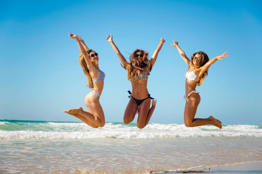 Three girls on the beach during in the air at a Florida bachelorette party