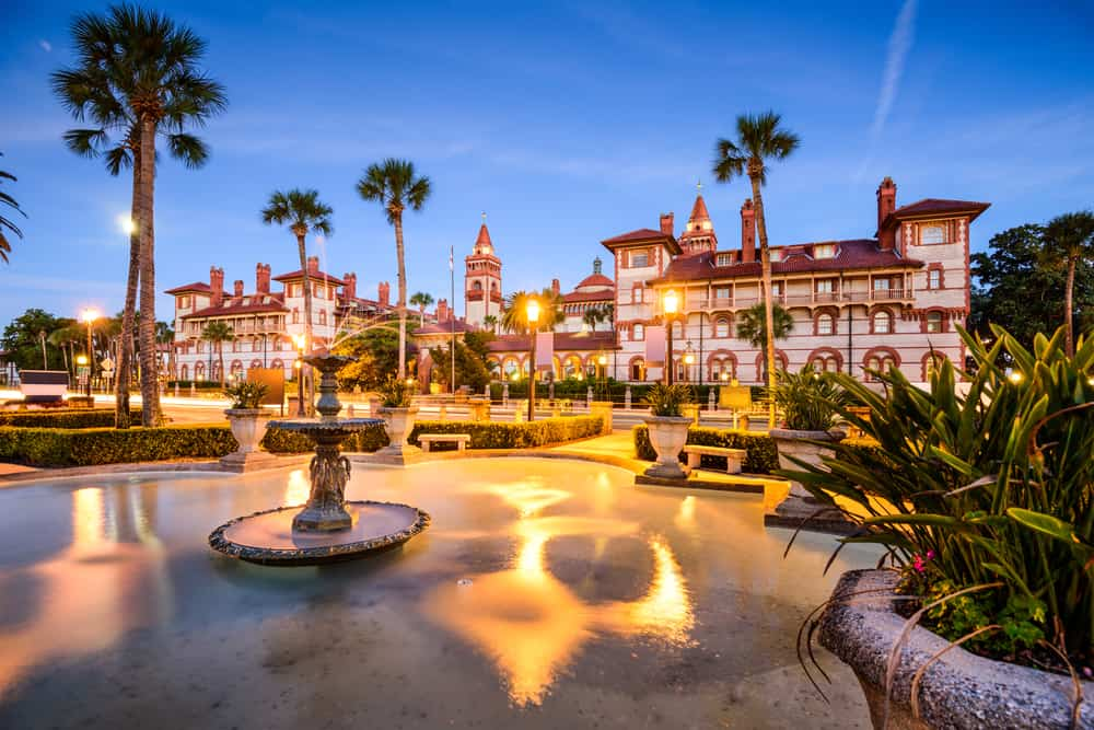 A beautiful Spanish style building in St Augustine with a fountain in the foreground.