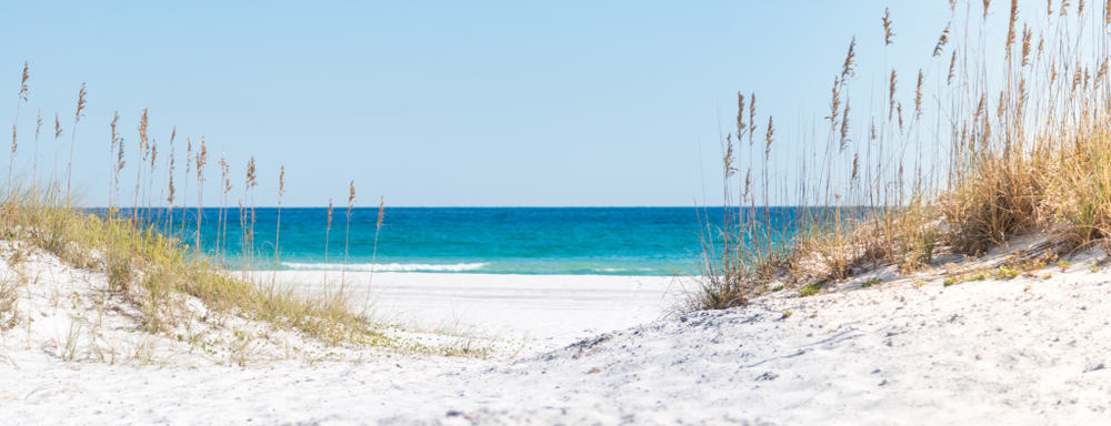 A white, sandy beach on Pensacola, fit for a beach trip on girls getaways in Florida