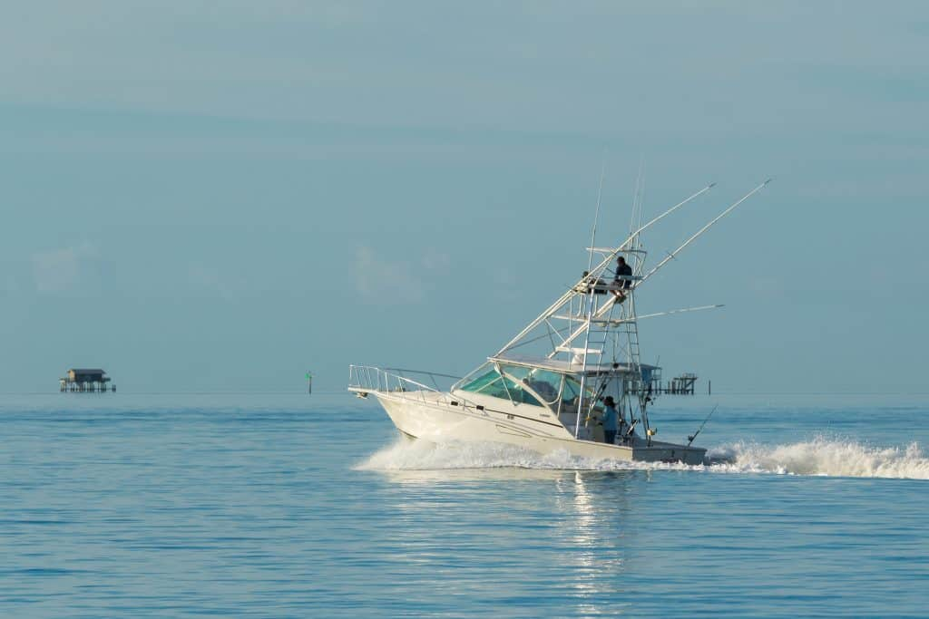 A deep sea fishing vessel ventures out onto the Naples Bay.