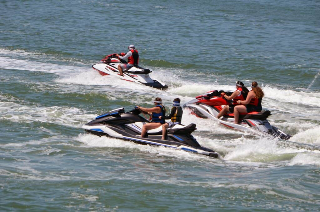 A tour guide shows around guest on jet skis on one of the best Naples boat tours.