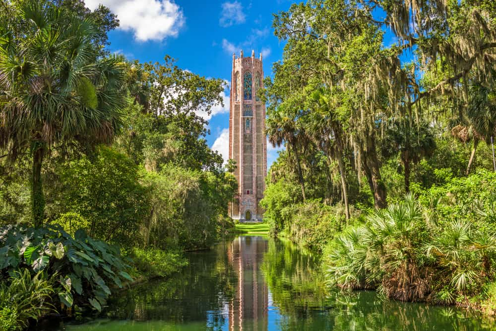 Bok Tower is reflected in the water of its garden, one of the best day trips from Naples.