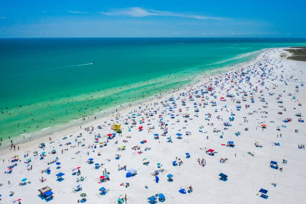 Sunbathers lie on the beach at Crescent Beach in Siesta Key.