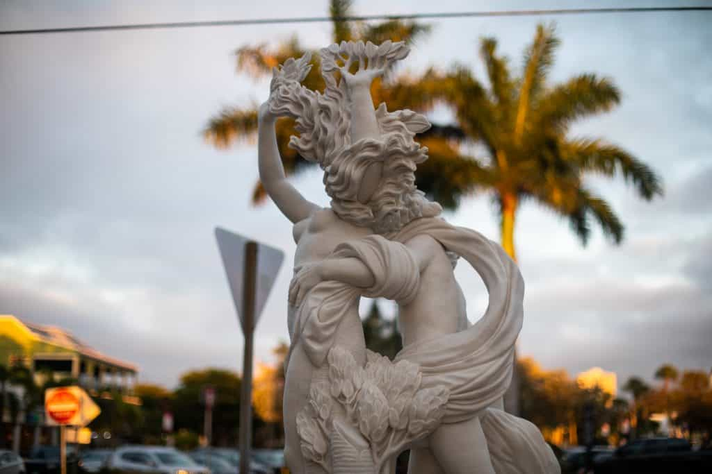 A statue stands in St. Armand's Circle, a beautiful are renowned for its architecture, one of the best things to do in Siesta Key.