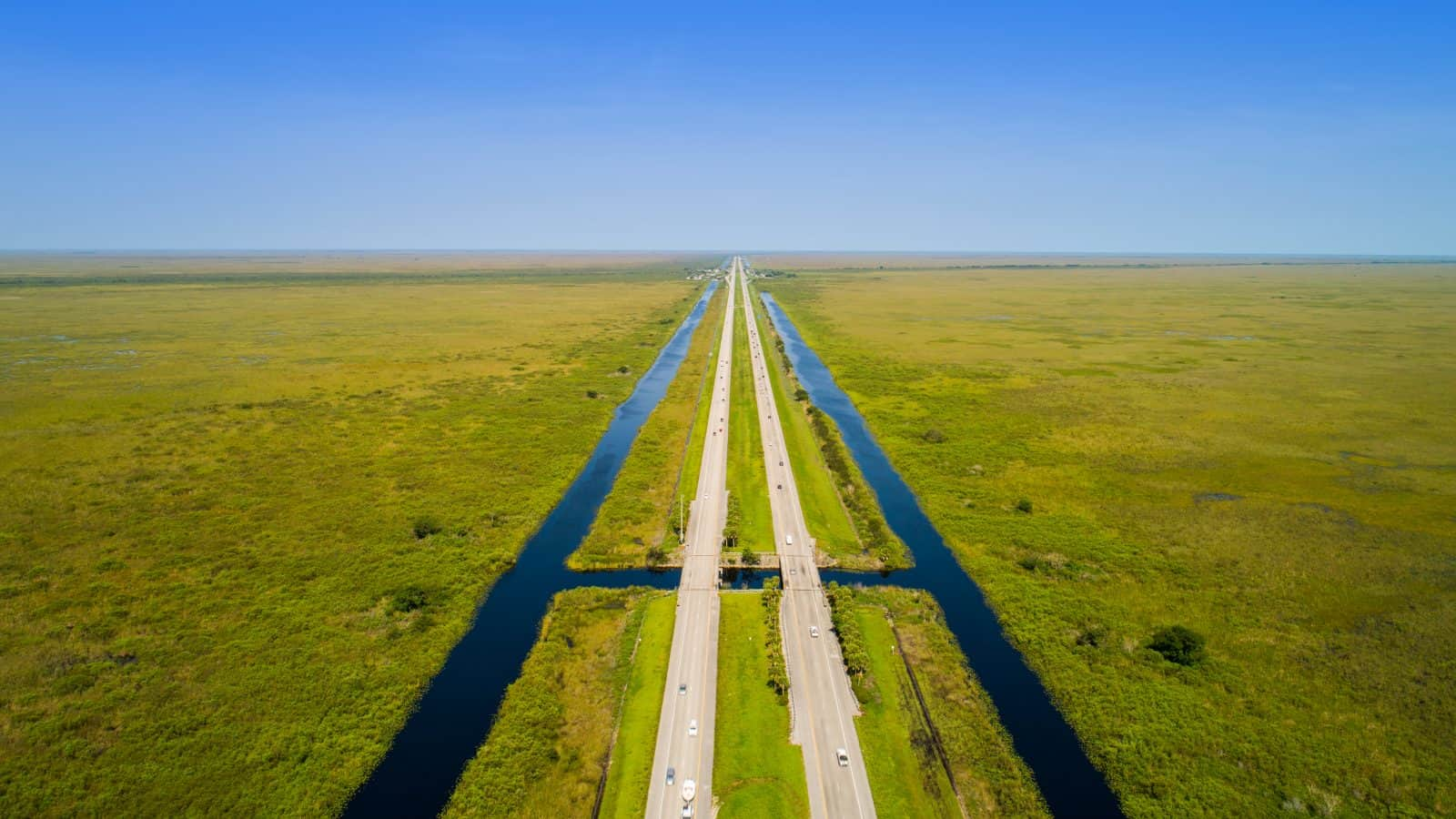 A drone captures the two lane highway of Alligator Alley in Florida.