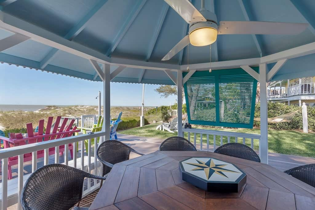 You are transported to a tranquil beachfront home at this property