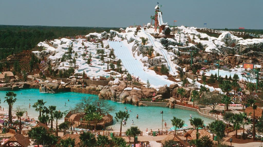 A wide view of the slopes and pool of Blizzard Beach