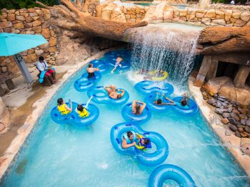inner tubes in a water park in florida with a waterfall