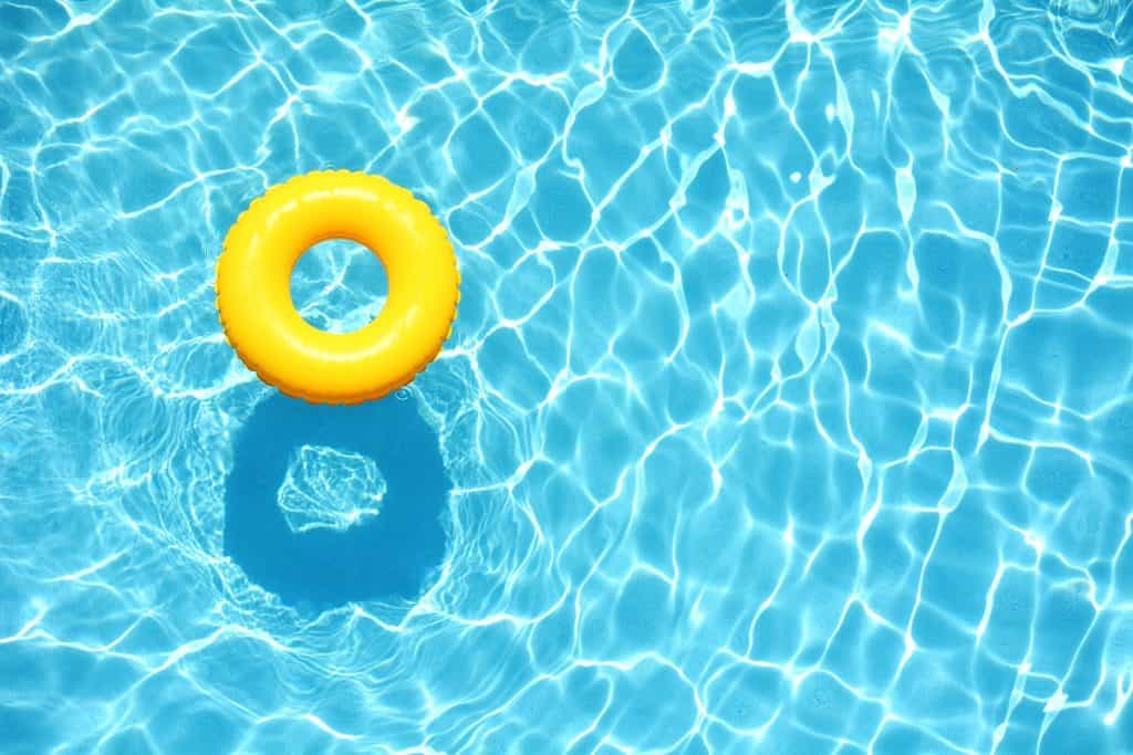 A yellow tube in a swimming pool.