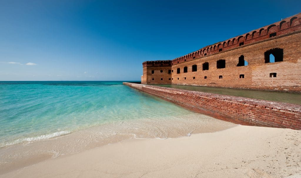Water washes up on the beach of Dry Tortugas National Parks, a can't miss attraction in the Florida Keys.